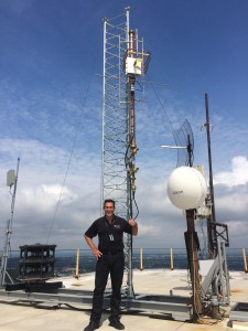 "Chief Operator  A.J. Fritz next to the ""Tower of Power"""